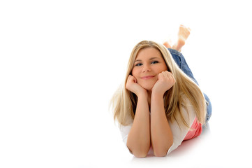 young casual smiling woman lying on the floor relaxing isolated
