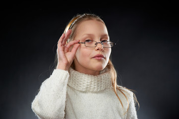 Portrait of a cheerful little girl in eyeglasses