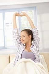 Young woman stretching in morning