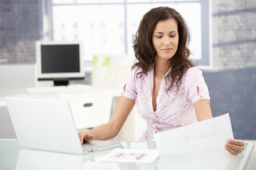 Attractive secretary working in bright office