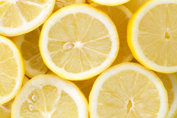 Background with cut lemons
