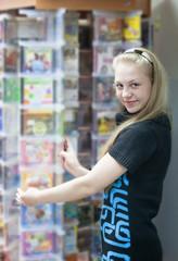 Girl in shop chooses disk