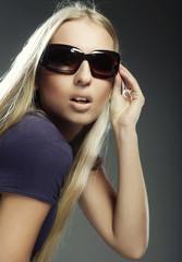 woman wearing the big modern sunglasses