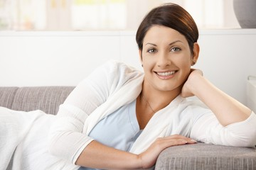 Portrait of happy woman resting at home