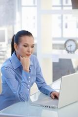 Smart businesswoman working on laptop computer