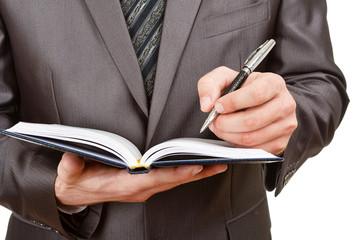 Canvas Afdrukken  - Businessman writing in business diary