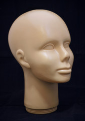 A human face wig holder