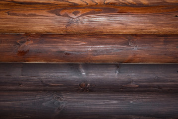 Bright and dark log wall construction