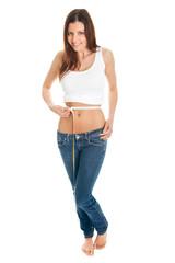 Beautiful woman measuring waist