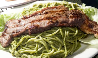 green spaghetti tallarin saltado steak Peruvian food
