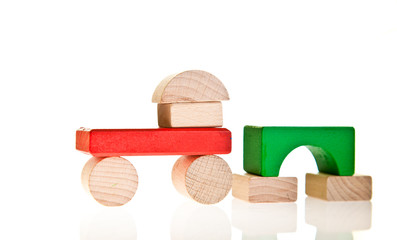 Wooden toy colorful blocks isolated on white