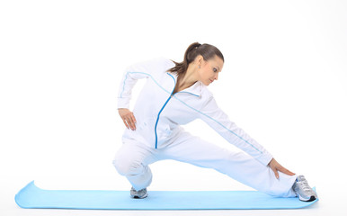 Woman doing stretching on a mat