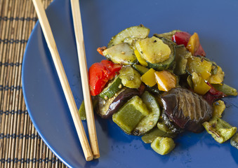 chopsticks and mixed grilled vegetables