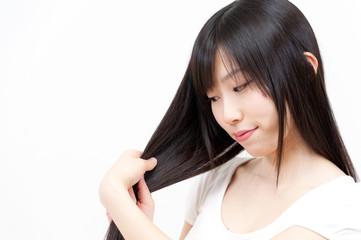 Fototapeta beautiful asian woman taking care of her hair