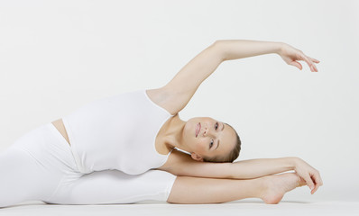 portrait of ballet dancer doing stretching