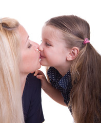 Child kissing her mother