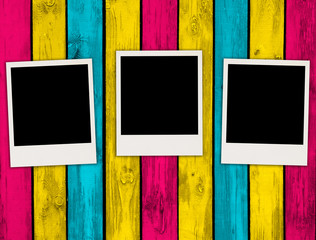 Three Photos on Multicolored Wood Background