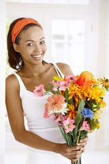 Happy woman with flower bouquet