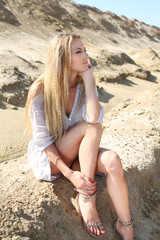 Fotobehang Beautiful blond girl in the summer day