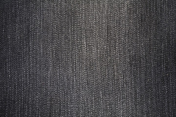 Dark jeans fabric with a visible structure as a background
