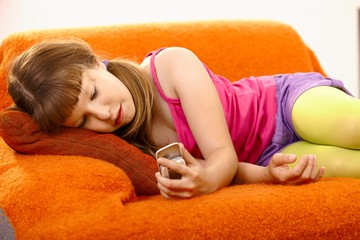 Young girl looking at mobile phone