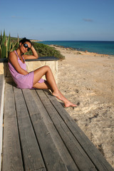 Young Woman On The Beach Of Formentera Island, Spain