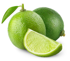 Isolated limes. Two whole lime fruits with leaves and a piece isolated on white background