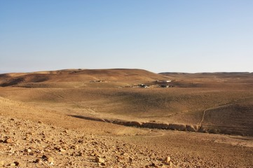Desert mountains and a Bedouin village