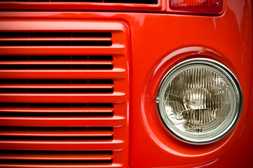 Wall Mural - red truck headlight with shallow d.o.f