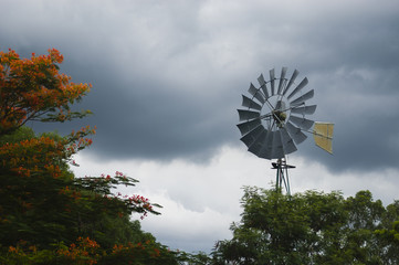 Windmill on a cloudy sky