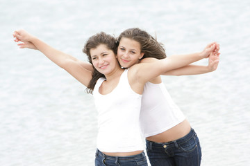 two happy women on sea background