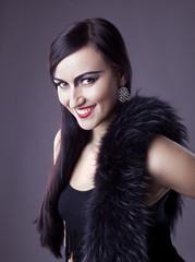 Beauty woman smile in fur boa - retro make-up