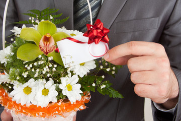 Fotobehang - Happy businessman with basket of flowers