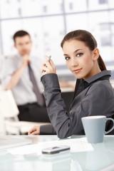Portrait of attractive female sitting at desk