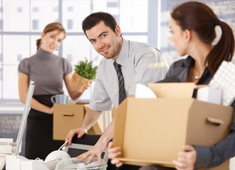 Young group of office workers moving to new office