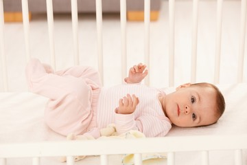 Beautiful infant in crib