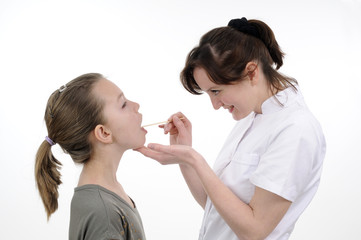 young doctor examining teenager mouth