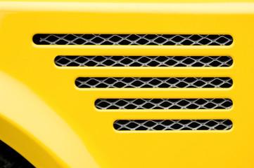 Wall Mural - bright yellow sports car engine grill closeup