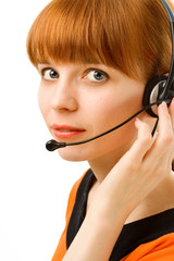 Portrait of a young female customer service operator on white