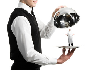 hands of waiter with cloche and chef