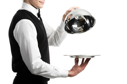 hands of waiter with cloche lid cover