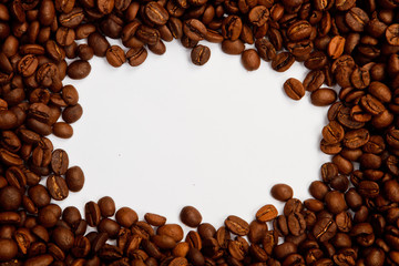 Brown roasted coffee beans. Shot in a studio