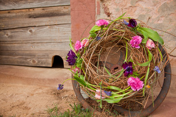 flower wreath leaning on a wall