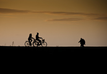 romantic bike ride at sunset