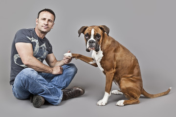 handsome muscle man with his dog