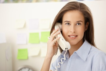 Portrait of woman on landline call
