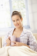 Happy woman with morning coffee