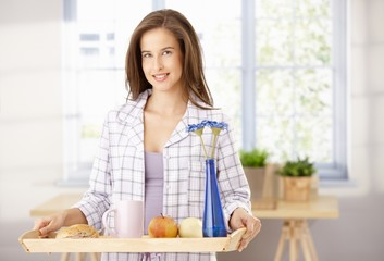 Happy woman with breakfast tray