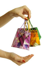 Shopping bags in hand, isolated