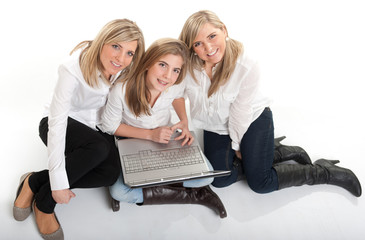 Happy girls with laptop
